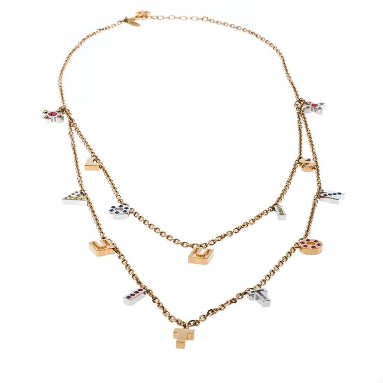 It is definitely Love At First Sight with this Louis Vuitton necklace. Beautifully designed with gold-tone metal, the piece has gorgeous layers of letters made from two-tone metal and set with crystals. The neckpiece is complete with a lobster