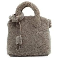 LOUIS VUITTON Gray Lockit Bag