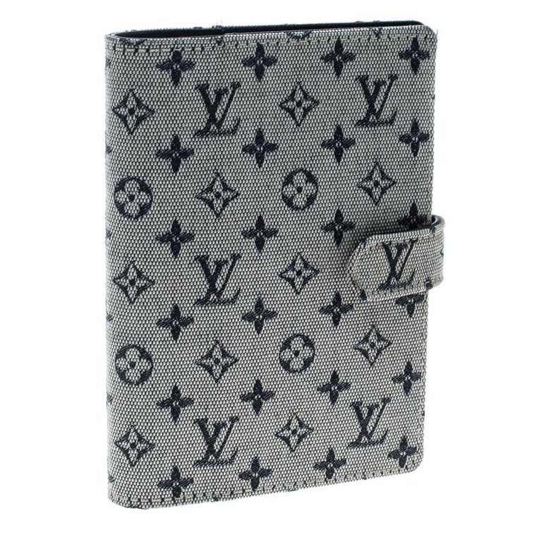 Functional creations like this one from Louis Vuitton are rare and worth the splurge. This Agenda Cover has a grey monogram canvas exterior and a leather interior housing multiple slots and rings for your papers. It is complete with a snap button in