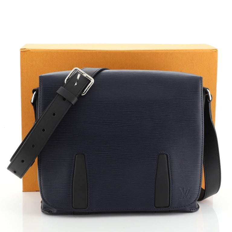 This Louis Vuitton Harington Messenger Bag Epi Leather PM, crafted from blue epi leather, features a leather shoulder strap, and silver-tone hardware. It opens to a black microfiber interior with zip and slip pockets. Authenticity code reads:
