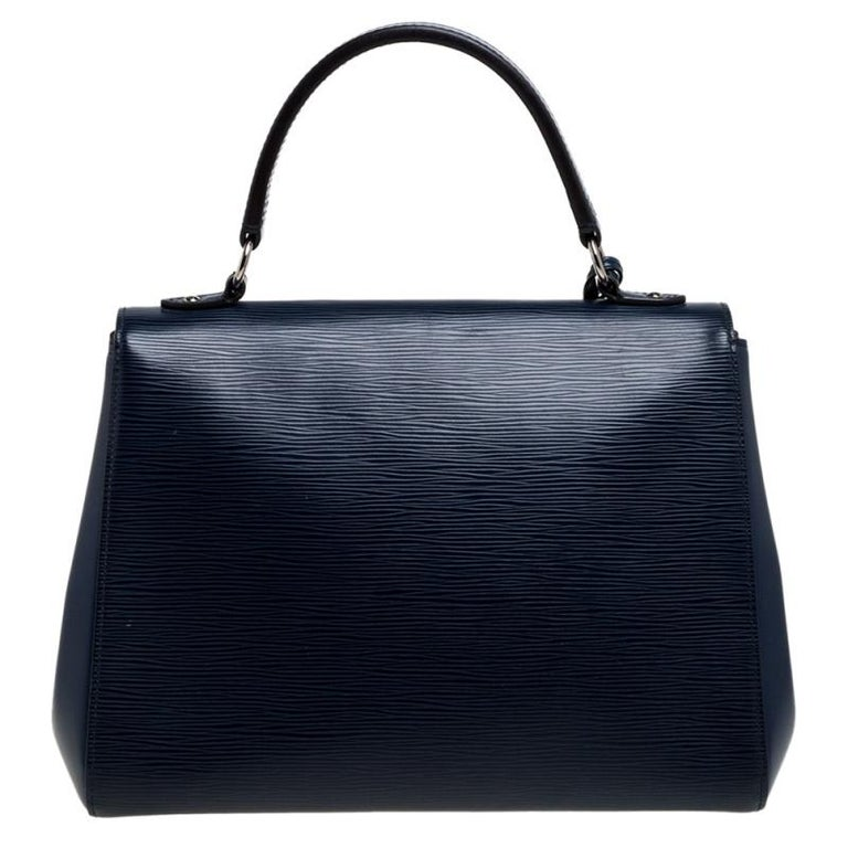All of Louis Vuitton's handbags are high on style and craftsmanship. Created from their signature Epi leather, the Cluny bag has a fine finish and a sleek silhouette. The bag features a top handle, a detachable shoulder strap, protective feet at the