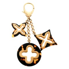 Louis Vuitton Insolence Brown Resin Gold Tone Bag Charm
