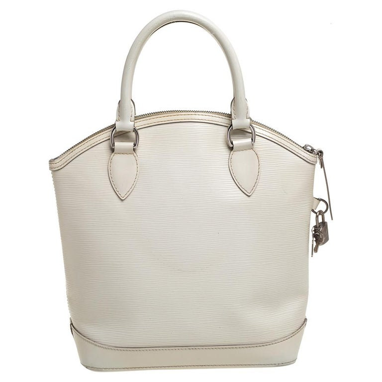 Louis Vuitton's handbags are popular owing to their high style and functionality. This Lockit bag, like all the other handbags, is durable and stylish. Crafted from epi leather, the bag comes with two rolled top handles and a zipper that opens to