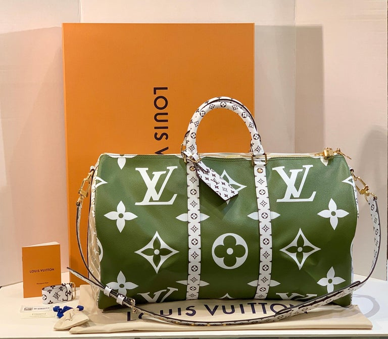 "Get the bag thousands of people are waiting for!  Brand  new and never used, with all tags, papers and packaging materials.  From the Louis Vuitton website, ""For Summer 2019, Louis Vuitton reinvents the Keepall Bandoulière 50 bag in a new bold"