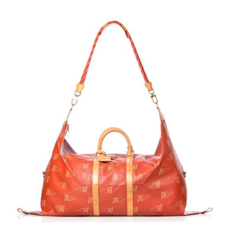 LV Cup 95's Kabul travel bag  Brown leather LV Cup 95's Kabul travel bag from Louis Vuitton Pre-Owned featuring round top handles, a detachable and adjustable shoulder strap, a top zip fastening, an all-over print, a hanging luggage tag and an
