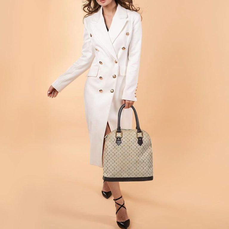 This Louis Vuitton bag will become your savior when you wish to comfortably carry all your essentials with a whole lot of elegance. Made from the signature Monogram Mini Lin canvas and leather, this Alma Haut bag is held by dual handles and has a