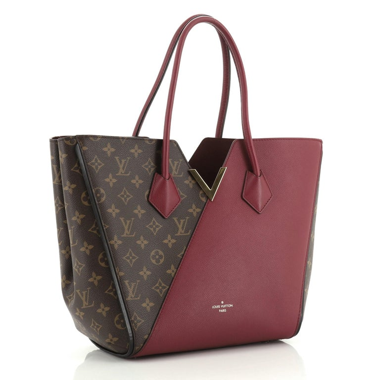 This Louis Vuitton Kimono Handbag Monogram Canvas and Leather MM, crafted from brown monogram coated canvas and red leather, features dual rolled handles, metallic V-cross accent, and gold-tone hardware. Its wide top with hook-clasp closure opens to