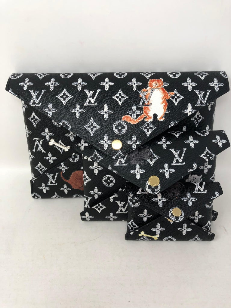 Louis Vuitton Kirigami Monogram Catogram Large Clutch. Designed by Grace Coddington for LV. Pop Up Exclusive. Very limited and rare. The Kirigami is a 3 piece set that is functional for everyday or for travel. Own this iconic piece. Includes