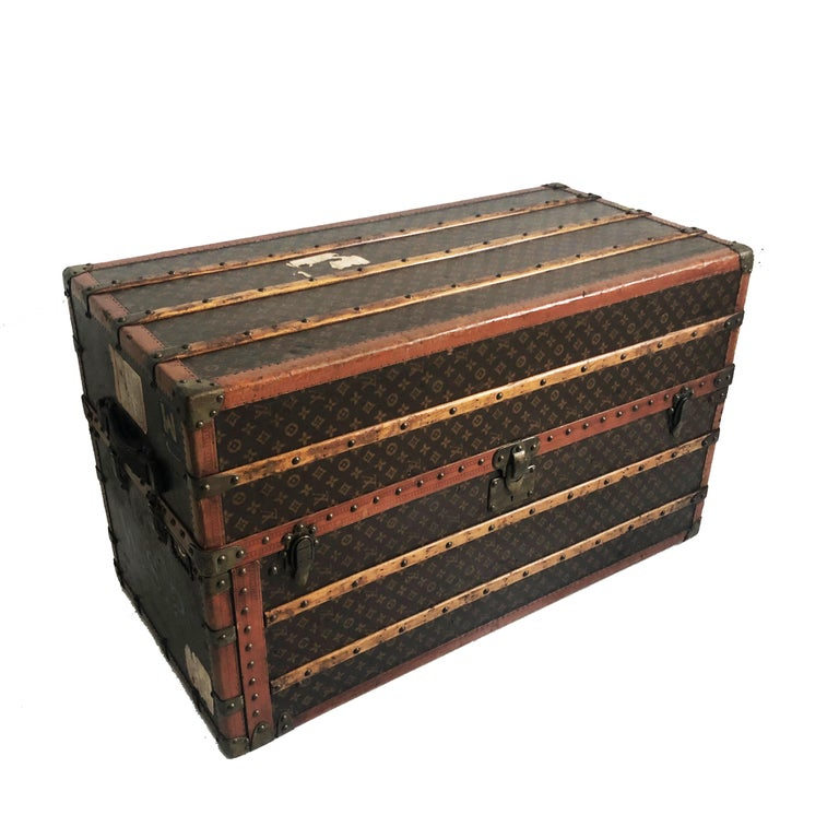 An impressive Louis Vuitton Large Wardrobe Steamer Trunk Travel Case from the early 20th C.  Made from Vuitton's monogram canvas, the interior features 6 drawers, 8 full hangers, 3 pant hangers, 1 cloth screen and a removable velveteen lined storage