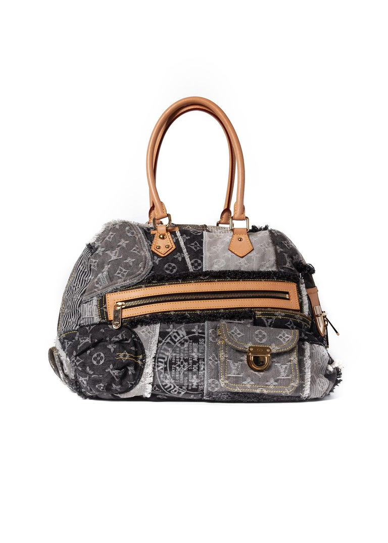 This Bowly Bag is made of blue monogram denim with patchwork design. The bag features dual top handles, a leather tag, leather finishes, brass hardware and a front and back push lock closure pockets. Top zip closure opens to a floral printed fabric
