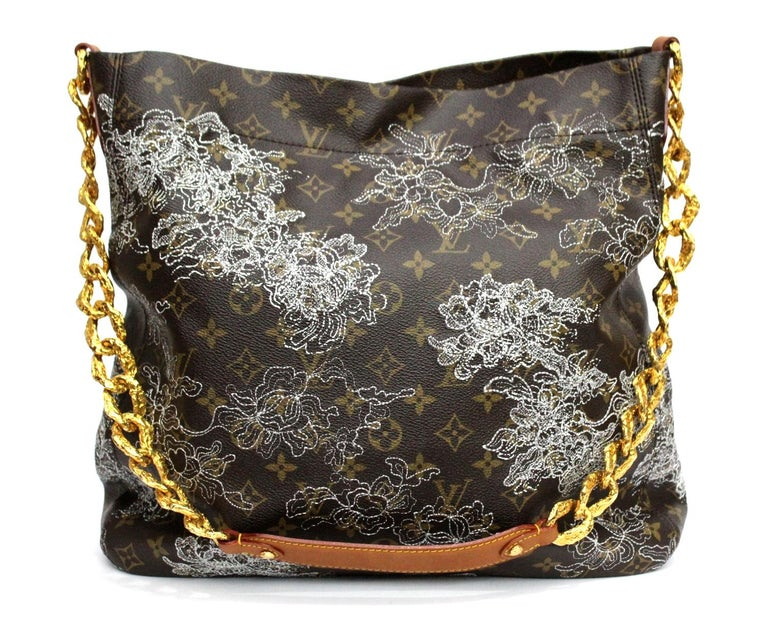 Created by Marc Jacobs for the '07 runway collection, the Dentelle Fersen features delicate lurex lace embroidery made from a real lace pattern and caramel leather trim. The gold hardware features an intricate texture that combines with the lace