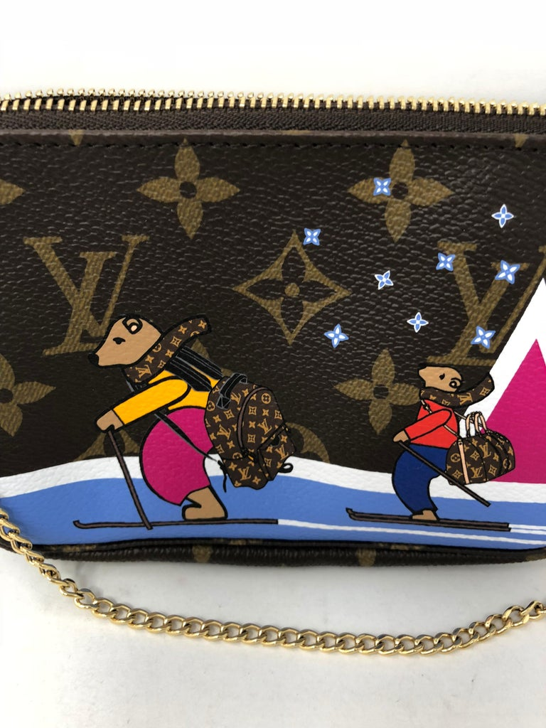 Louis Vuitton Limited Edition Mini Pochette. Holiday scene 2018. Brand new comes with dust cover and box.