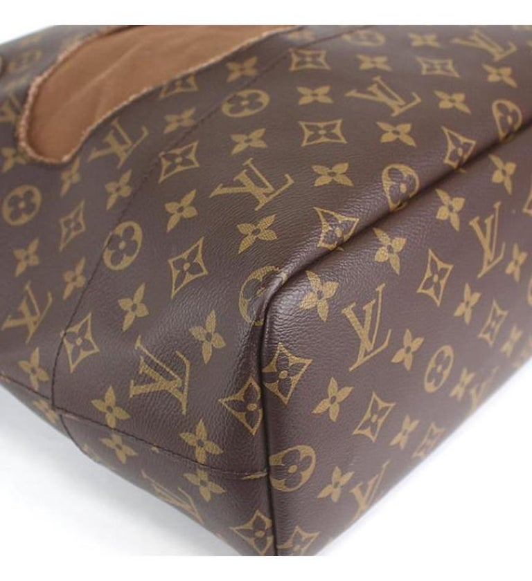 Louis Vuitton Limited Edition Monogram Brown Cut Out Carryall Travel Tote Bag For Sale 2