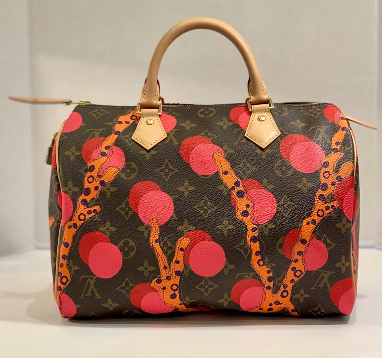Coveted, limited edition Louis Vuitton Speedy 30 handbag in Grenade Ramages Monogram canvas with beautiful, coral reef inspired colors and a playful pattern from the LV Summer 2015 collection.  Bag features gold tone metal hardware with a zipper