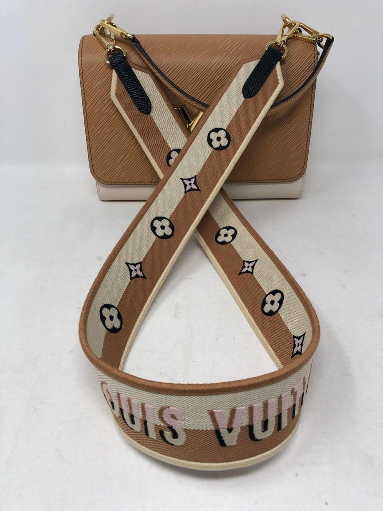 Louis Vuitton Limited Edition Epi Leather Two-tone Twist Bag. Brand new never used. Unique interlocking clasp spells LV. Gold hardware. Own this rare and unique piece. Includes original dust cover and box. Guaranteed authentic.
