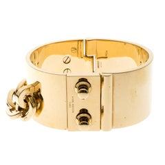 Louis Vuitton Lock Me Manchette Gold Tone Wide Cuff Bracelet