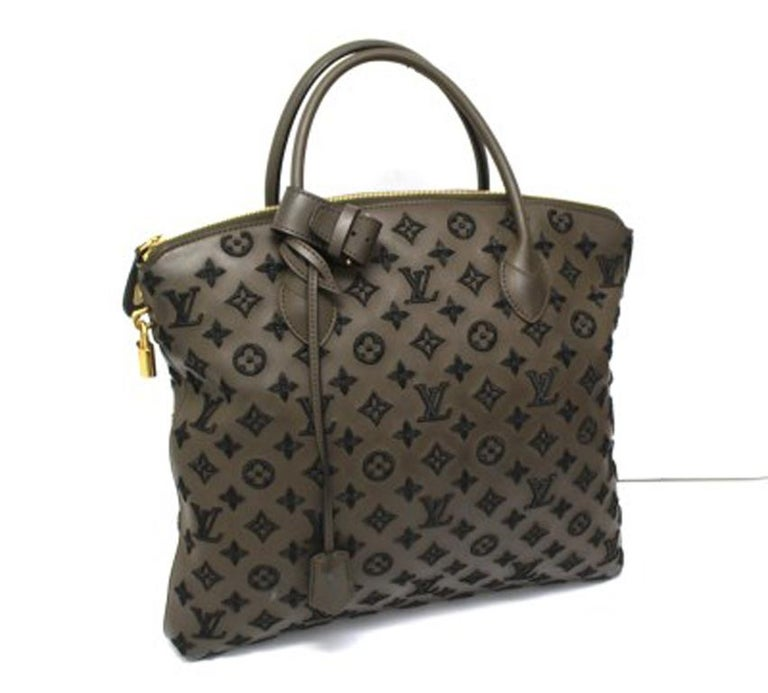Louis Vuitton bag, Lockit model, limited edition 20112012 collection, made of matte brown leather with raised black laminated thread monogram and golden hardware. The product is equipped with a zip closure, internally lined in black suede, quite