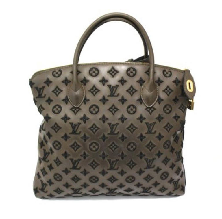 Louis Vuitton Lockit Limited Edition Handbag in Brown Leather & Golden Hardware In Good Condition For Sale In Torre Del Greco, IT