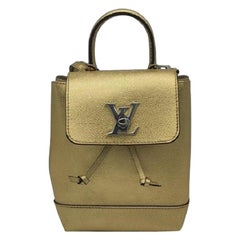 LOUIS VUITTON Lockme Backpack in Gold Leather