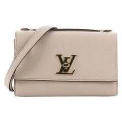 Louis Vuitton Lockme Clutch Leather