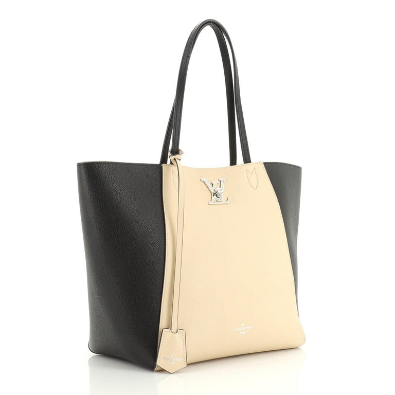 This Louis Vuitton Lockme Cabas Leather, crafted from black and neutral leather, features dual slim leather handles and silver-tone hardware. Its LV turn-lock closure opens to a neutral microfiber interior with zip and slip pockets. Authenticity