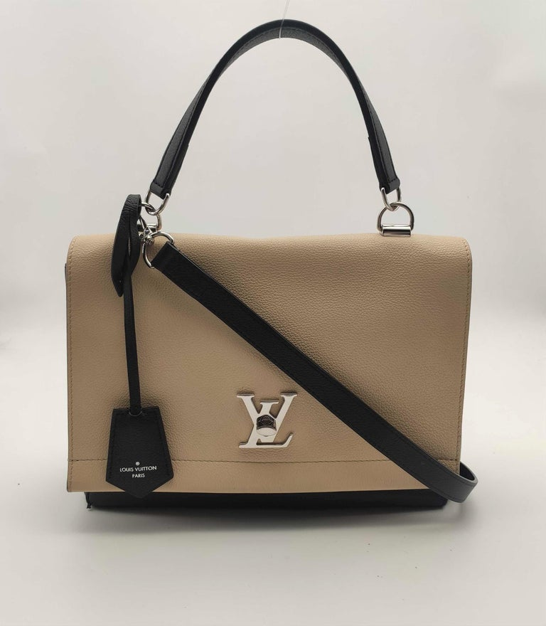 - Designer: LOUIS VUITTON - Model: Lockme - Condition: Very good condition. Exterior stains, Sign of wear on Leather, Interior stains - Accessories: None - Measurements: Width: 29cm, Height: 21cm, Depth: 9.5cm, Strap: 104cm - Exterior Material: