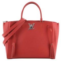Louis Vuitton Lockmeto Handbag Leather