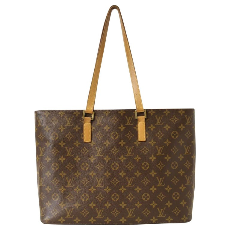 Vintage LV bag Vintage Monogram canvas Brown color Beige vacchetta double handles with little dischromias Internal alcantara lining One internal pocket with zip closure Other four pockets Cm 30x43x11 (11,81x16,92x4,33 inches) Worldwide express