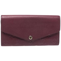 Louis Vuitton Maroon Monogram Empreinte Leather Sarah Wallet