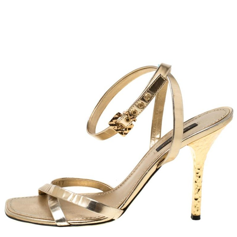 Designed with metallic gold leather straps, these sandals from Louis Vuitton are minimal yet gorgeous. They feature open toes, leather insoles and are elevated on 10.5 cm heels. Show them off in a midi dress and a Chanel flap bag.  Includes The