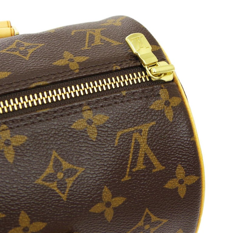 Monogram canvas Leather Gold tone hardware Woven lining Made in France Date code present Strap drop 6.5