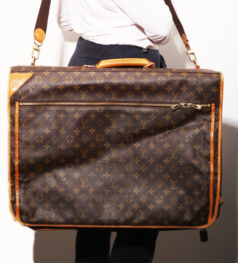 Louis Vuitton Monogram Garment Bag Luggage Carrier.  This beautiful garment bag is in good condition. There is some wear on the outside but very little and it still looks like new. The inside of the bag has a few openings that all have zippers