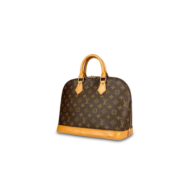 Brown and tan monogram coated canvas Louis Vuitton Alma PM with  – Brass hardware – Tan vachetta leather trim – Dual rolled top handles – Brown canvas lining – Single slip pocket at interior and two-way zip closure at top  Overall Preloved