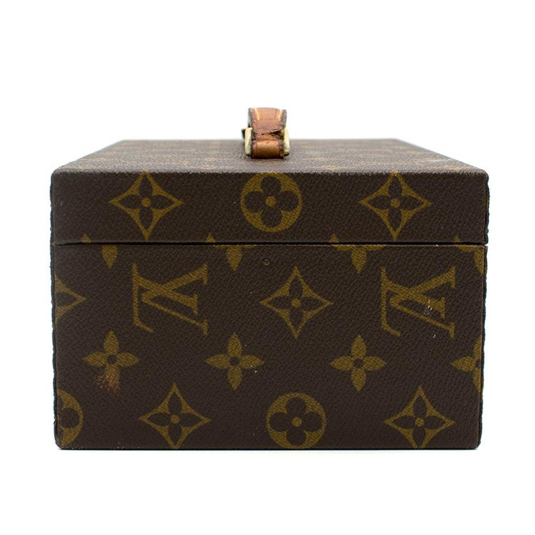 Louis Vuitton Boite a Tout bag in the iconic logo print. Featuring gold-tone hard-wear, a push-lock fastening, two keys to secure the lock and a flat top handle. The inside of the box has a small pocket.     Please note, these items are pre-owned