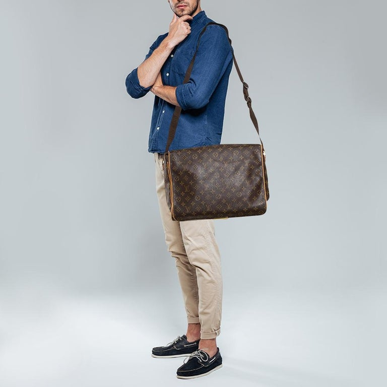 This Abbesses messenger bag from Louis Vuitton comes filled with excellent style and craftsmanship. The bag has an exterior crafted from Monogram canvas and has a canvas lining. The bag carries a shoulder strap and a spacious interior that will
