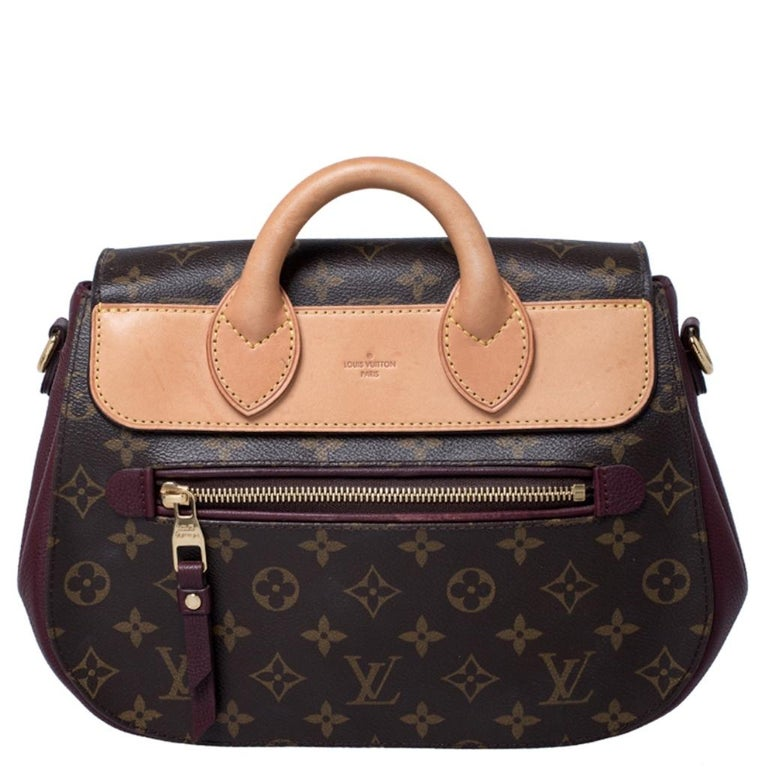 A perfect pick for endless style and fashion-filled sprees is this Eden. This Louis Vuitton creation has been beautifully crafted from monogram coated canvas and styled with a flap that has a push lock. The insides are lined with Alcantara and sized