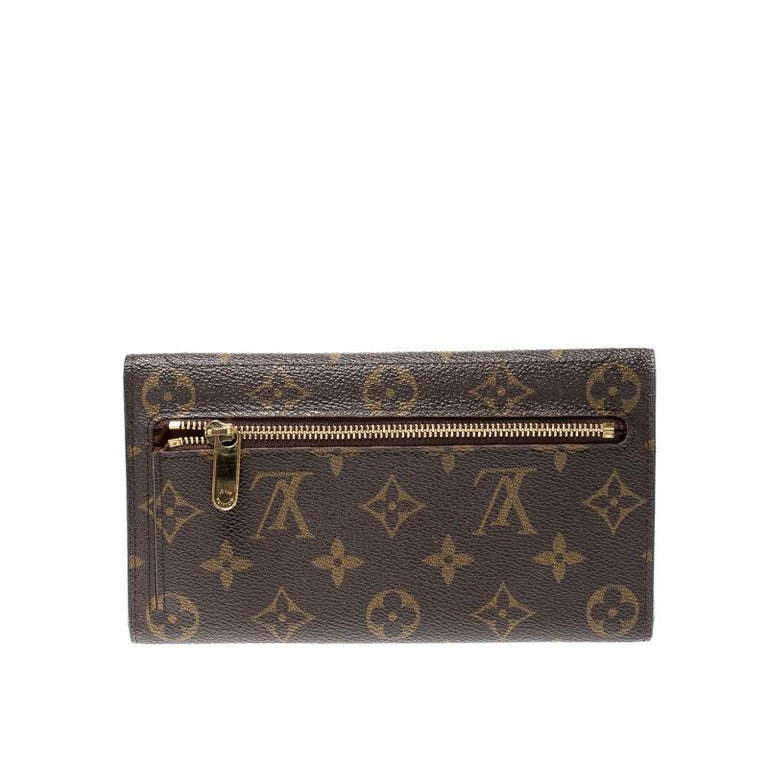 Stylish wallets are a closet must-have! This Eugenie wallet from the house of Louis Vuitton has been crafted from Monogram canvas in France. It has been styled as a trifold with a push-lock flap that opens up to a leather interior housing multiple