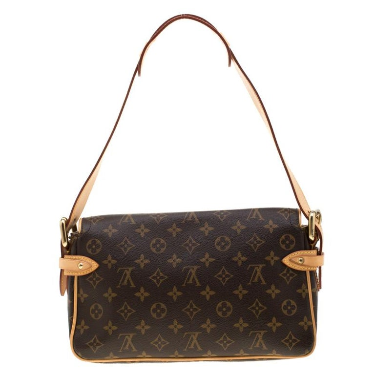 This Hudson PM by Louis Vuitton is a handbag you can carry for years to come. It features easy-to-match monogram canvas exterior with leather trims, dual push button front pockets, flap front buckle closure and a single leather shoulder strap. The