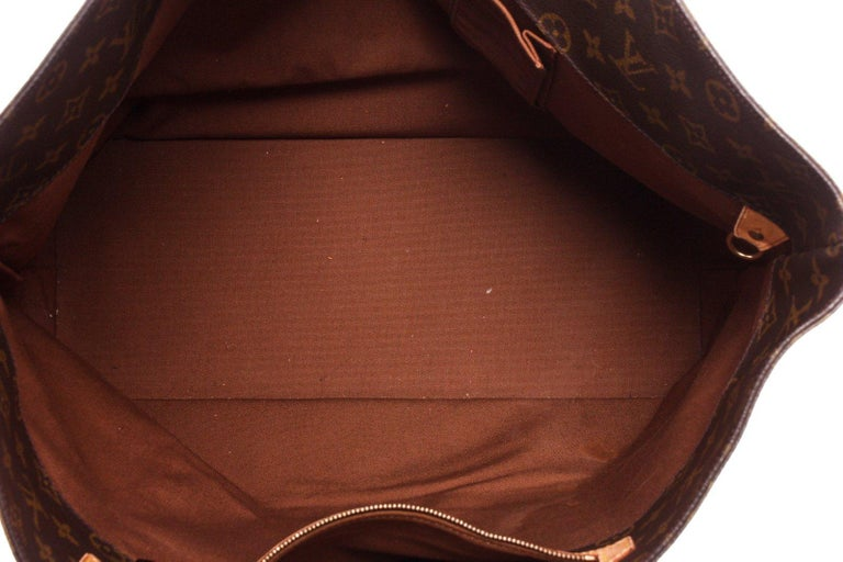 Brown and tan monogram canvas Louis Vuitton Monogram Cabas Alto tote with brass hardware, tan vachetta leather trim, dual flat shoulder straps, brown canvas lining, dual pockets at interior walls, single zip pocket and open at top.  20746MSC