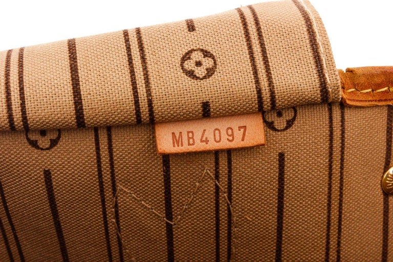 Brown and tan monogram coated canvas Louis Vuitton Neverfull PM with brass hardware, tan vachetta leather accents, dual flat top handles, tan and brown striped canvas lining, single zip pocket at interior wall and clasp closure at top.  25545MSC