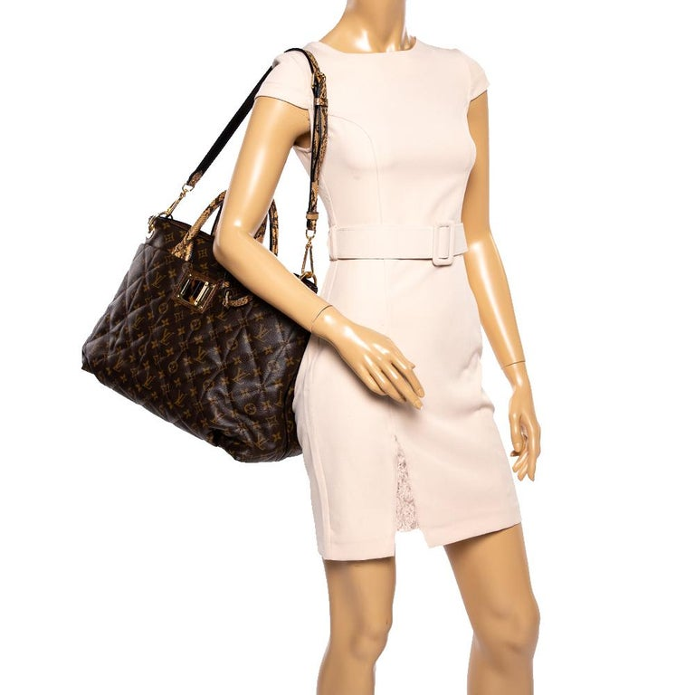 This luxurious and rare edition of the Etoile Exotique bag from Louis Vuitton is crafted in signature LV monogram canvas and has a quilted exterior. High on style and functionality, it is equipped with top handles and a detachable shoulder strap,