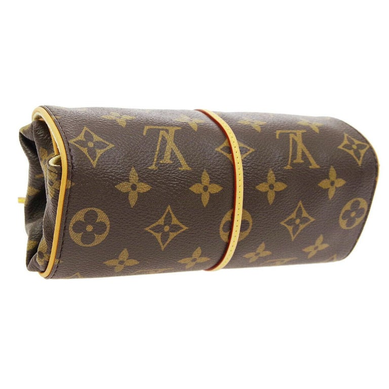 Monogram canvas Leather  Gold tone hardware  Velvet lining Tie closure Date code present Made in France Measures 8