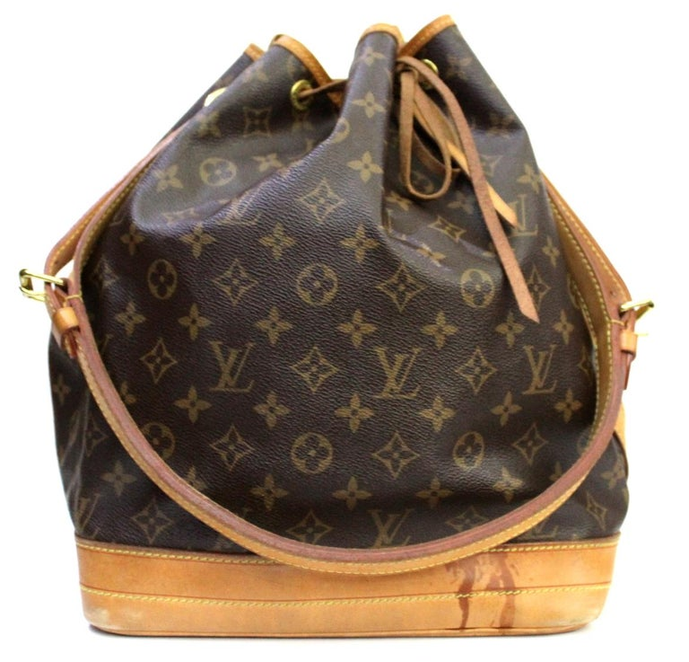 The Louis Vuitton Monogram Canvas Petit Noe Bag is a timeless and favored piece that will never go out of style. It was originally created in 1932 to carry five bottles of Champagne. With its spacious interior and leather drawstring closure, this