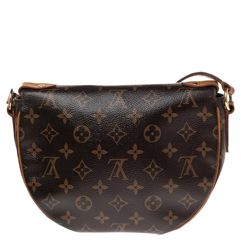 Crafted from Monogram canvas & leather, this Louis Vuitton Saint Cloud bag is a closet essential. It features a flap design with a snap closure that opens to a canvas-lined interior with enough space. It is further adorned with a front flap and