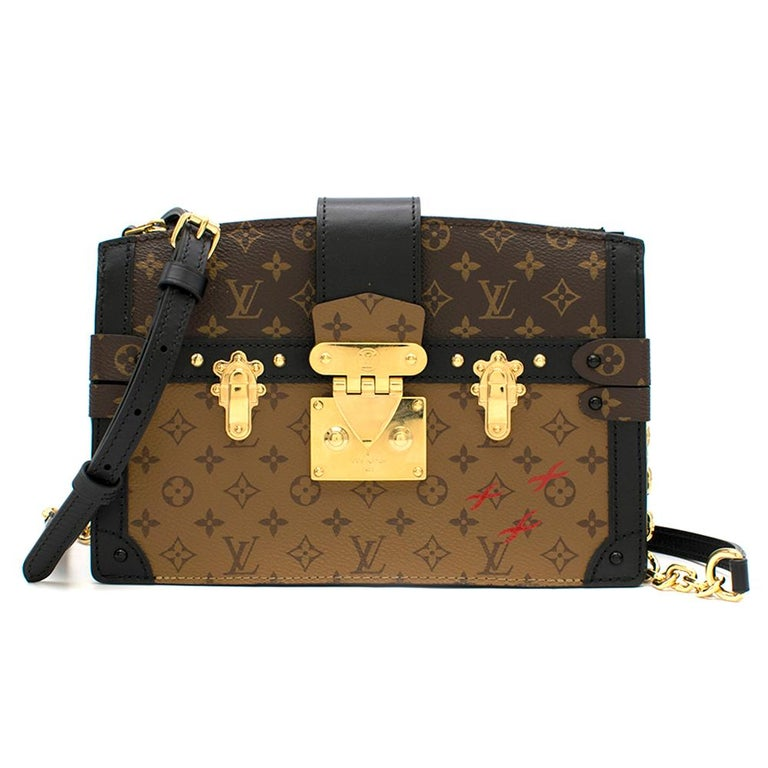 Louis Vuitton Monogram Canvas Trunk Clutch   - Monogram & Monogram Reverse print - Sold out - soft-sided reinterpretation of the iconic Petite Malle - Calf-leather trim - Sheepskin lining with Malletage print - Gold-coloured hardware - Removable