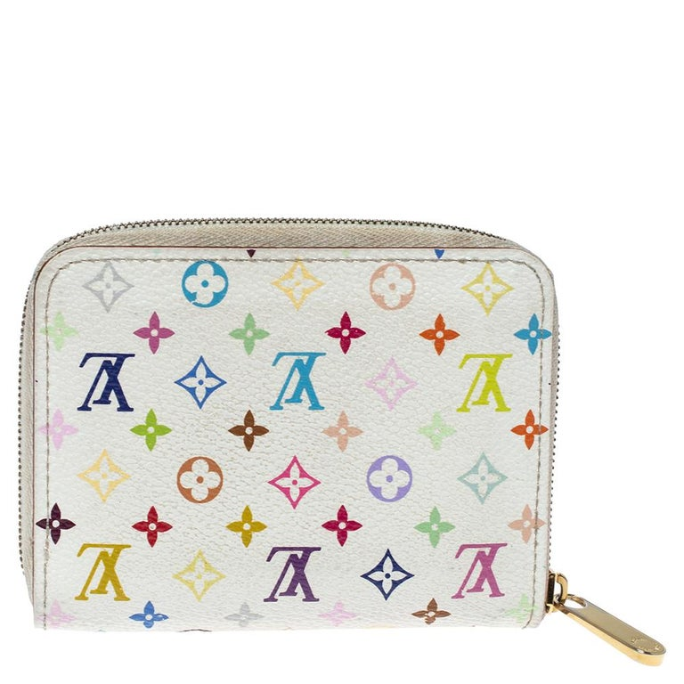 This Louis Vuitton Zippy coin purse is conveniently designed for everyday use. Crafted from colorful monogram coated canvas, the wallet has a zip closure that opens to reveal multiple slots for you to neatly arrange your coins.
