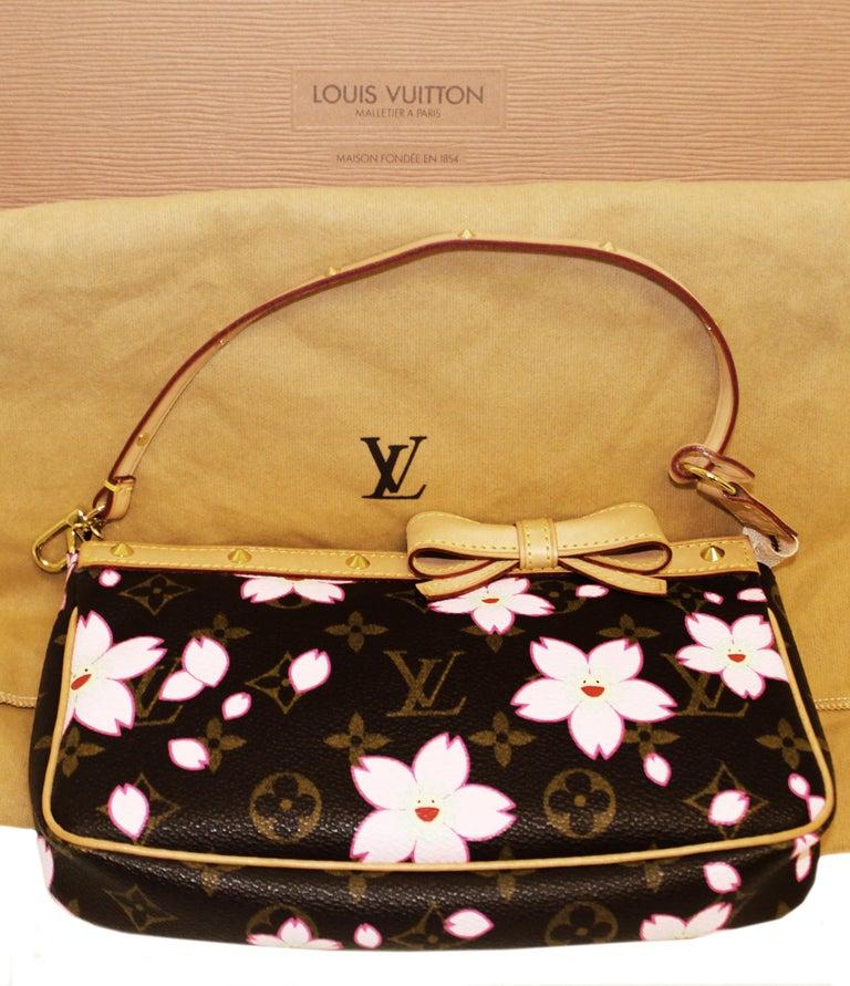403b16942c Louis Vuitton Monogram Cherry Blossom limited edition pochette bag includes  a detachable leather strap. The