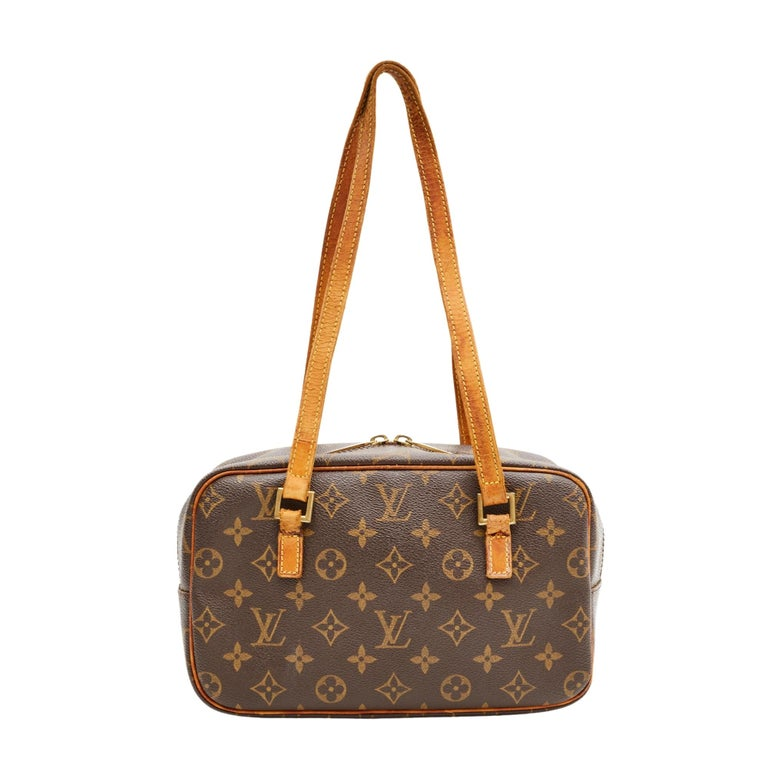 This bag is made with brown monogram coated canvas with nice light caramel natural leather finishes. The bag features a front zip compartment, top zip closure with double zippers, dual flat top handles and a terra-cotta cross grain leather