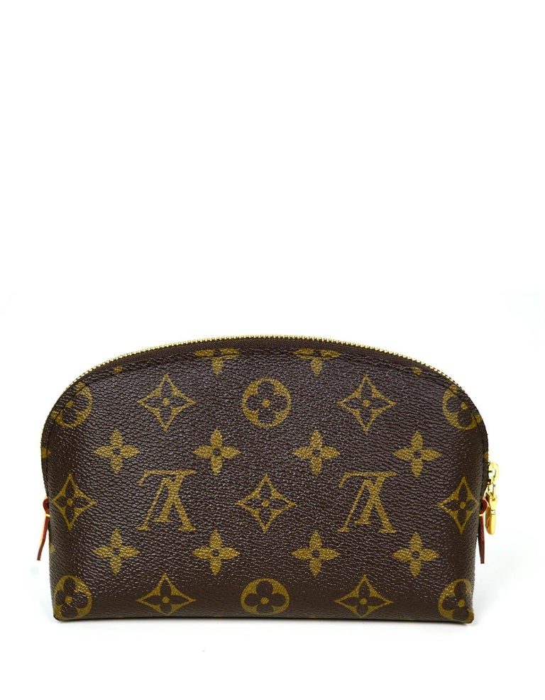 Louis Vuitton Monogram Cosmetic Pouch Bag  Made In: France Year of Production: 2017 Color: Brown Hardware: Goldtone brass Materials: Monogram coated canvas with vachetta leather Lining: Beige washable textile Closure/Opening: Zip top Exterior