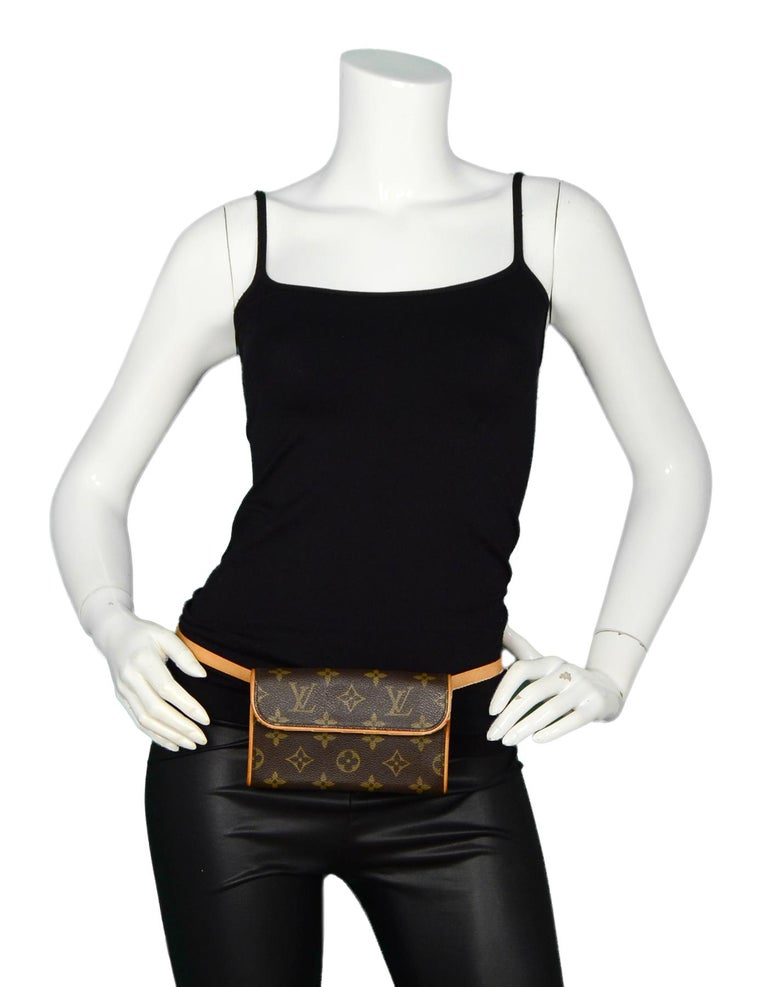 Louis Vuitton Monogram Coated Canvas Pochette Florentine Belt Bag  Made In: France Year of Production: 2003 Color: Brown Hardware: Antique goldtone hardware Materials: Coated canvas, leather trim Lining: Beige suede lining Closure/Opening: Top flap
